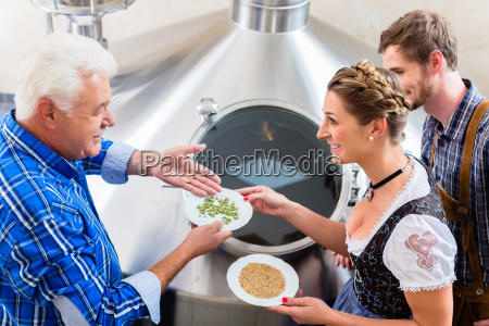 brewer and couple in beer brewery