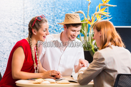 couple in travel agency booking vacation