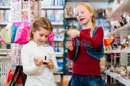 two kids buying toys in toy