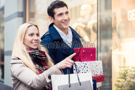 couple at shop window doing christmas
