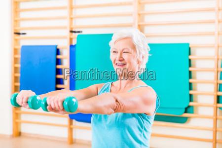 senior woman doing fitness sport in
