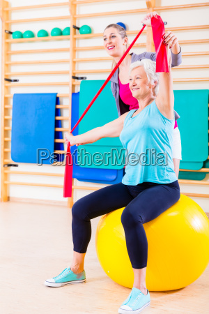 senior woman with stretch band at
