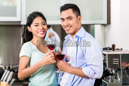 asian couple drinking red wine in