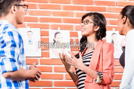 team in advertising agency choosing pictures