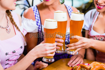 close up of people drinking beer