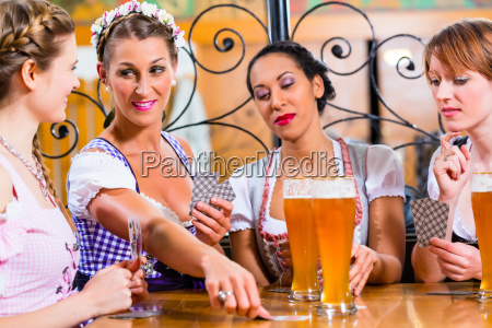 friends playing cards in inn or