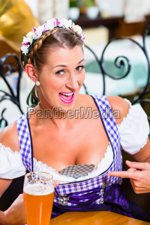 bavarian, woman, with, playing, cards, in - 21492605