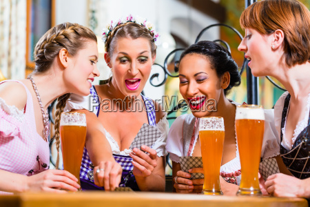 women, in, bavarian, pub, playing, cards - 21492599
