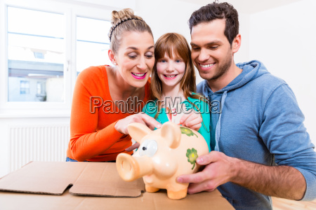 family saving money by moving house