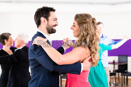 young and senior couples getting dance