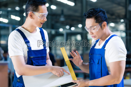 carpenter team in asian wood workshop