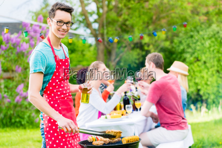 yong man at the bbq grill