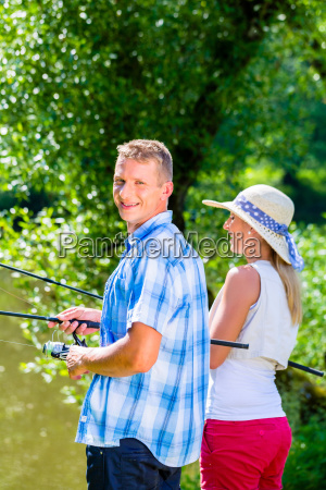 young couple fishing or angling standing