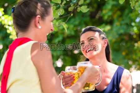women in beergarden having refreshment