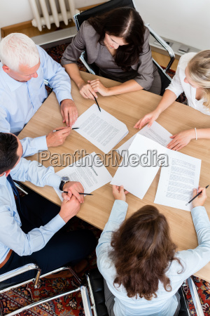 lawyers having team meeting in law