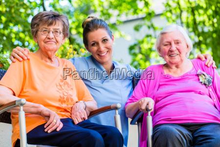 geriatric nurse having chat with senior