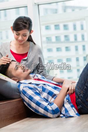 asian girl caressing her boyfriend