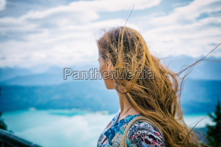 woman in alp mountains looking at
