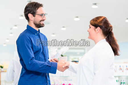 man in drug store with sales