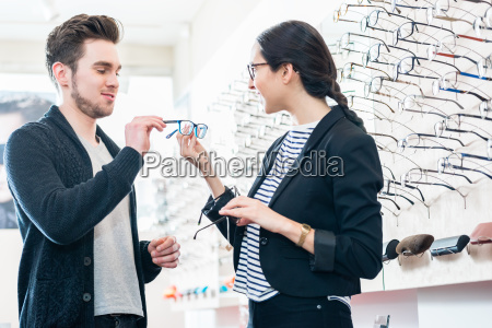 woman and man buying glasses in