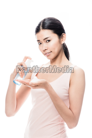 young asian woman pouring on hand