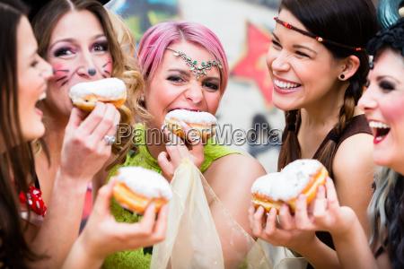 girls at german fasching carnival eating