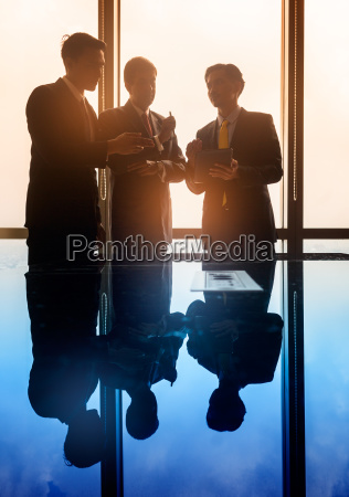asian business people having conversation in