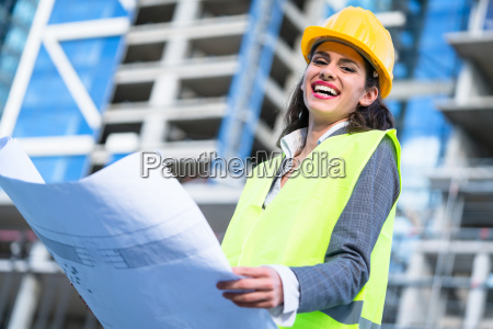 female civil engineer studying drafts visiting