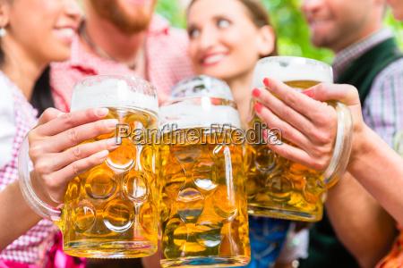 friends having fun in beer garden