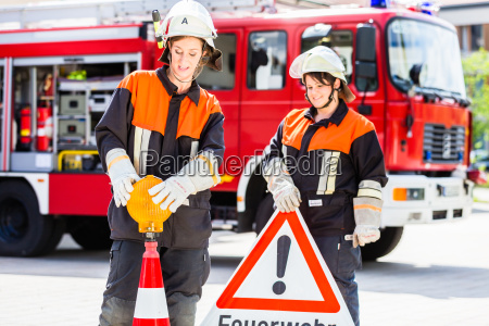 female fire fighters setting up attention