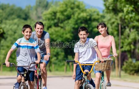 family of four on bike tour