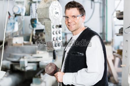 stonemason operating stone saw