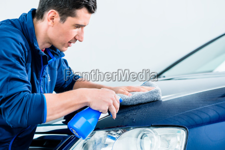proud car owner cleaning his vehicle
