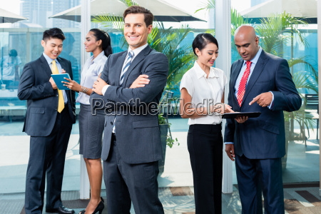 business executive in front of his