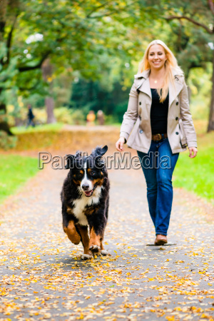 woman and dog at retrieving stick