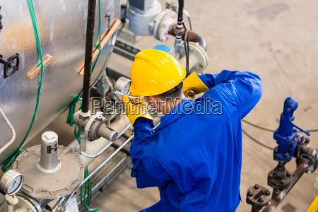 industrial worker working at machine