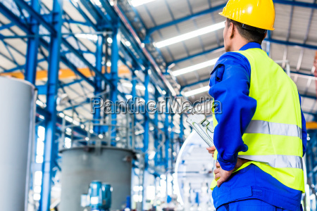 industrial worker in factory with tools