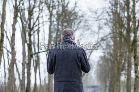 sad and lonely man walking in
