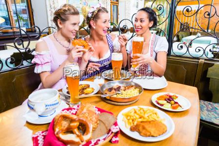 women eating lunch in bavarian restaurant