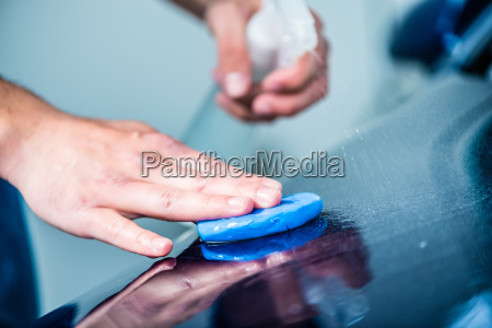 close up of male hands waxing