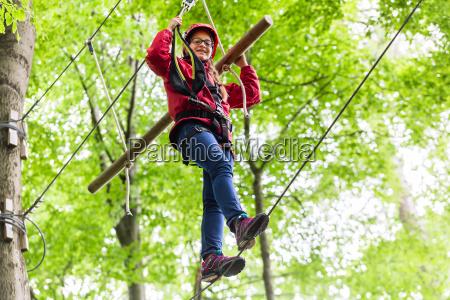 child reaching platform climbing in high