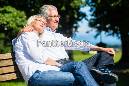senior woman and man resting on