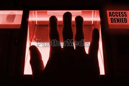 a person uses a fingerprint scanner
