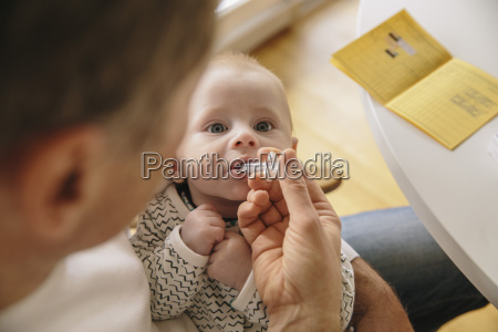 three month old baby receiving oral