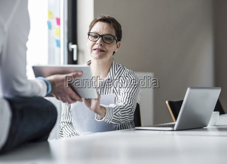 businesswoman and businessman working in conference