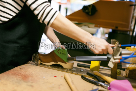 close up of clogmaker working in