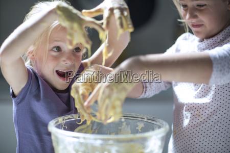 girls baking in kitchen