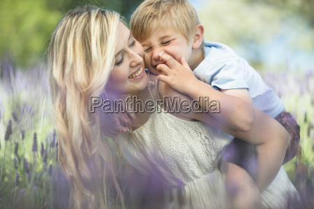 happy mother with son in lavender