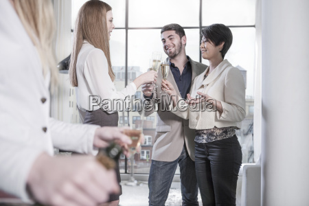 couple and friends having champagne in