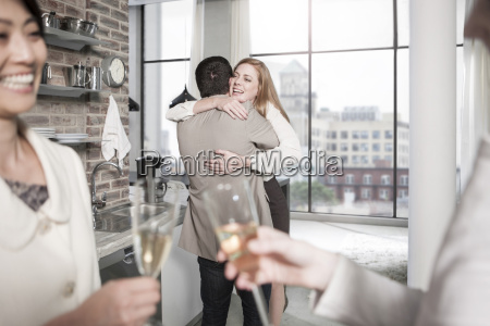man and woman hugging in kitchen